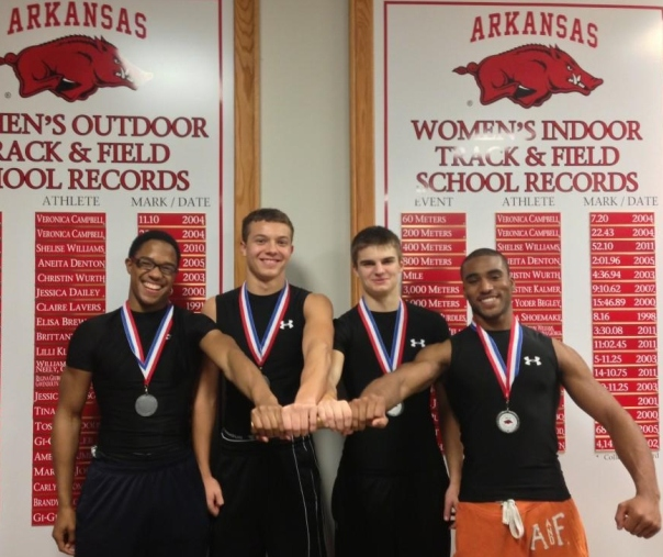 The Edwardsville Track Club quartet of Bennett Gray, Brian Crowe, Isaiah Michel, and Craig James celebrate their victory at the Arkansas HS Invitational on Saturday. Photo courtesy of Edwardsville track.